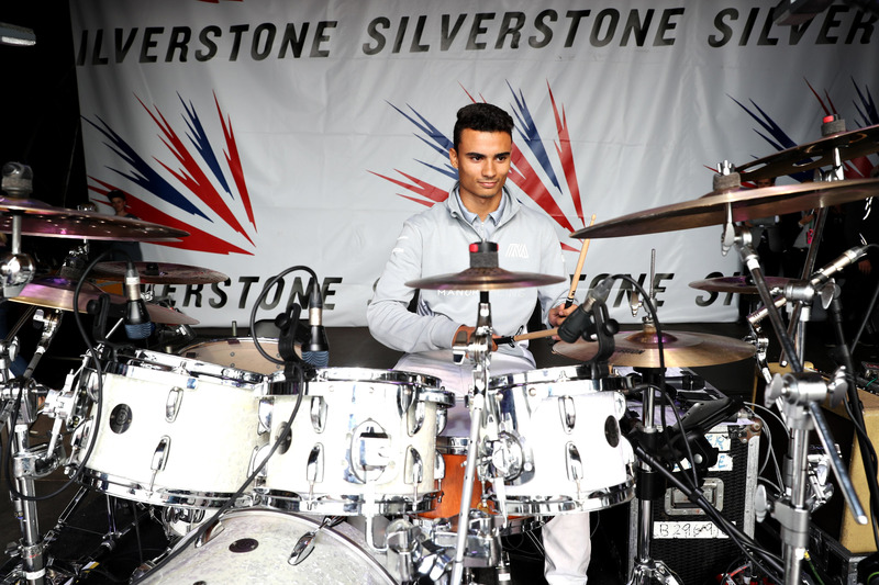 Pascal Wehrlein, Manor Racing play drums on the Silverstone stage