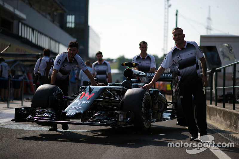 McLaren MP4-31 pushed down the pit lane