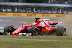Sebastian Vettel, Ferrari SF70H, with a front puncture