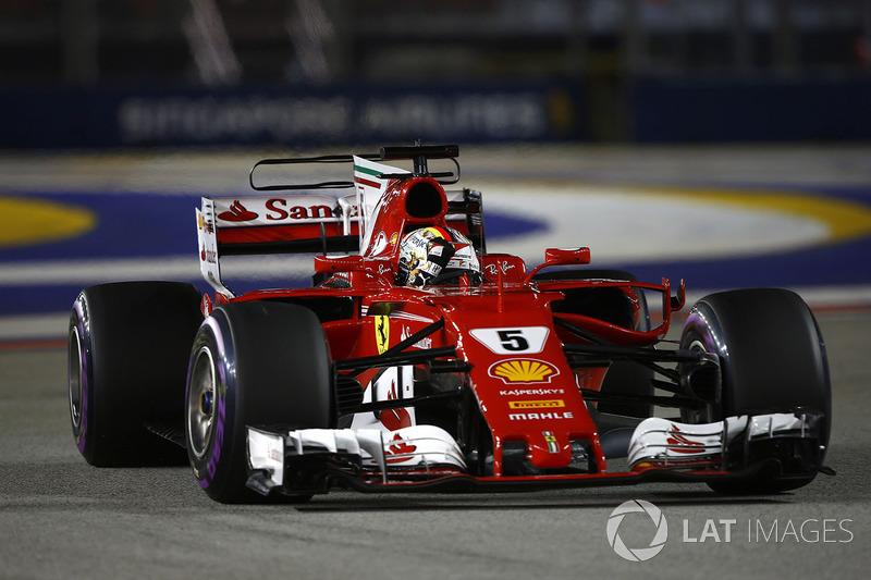Pole man Sebastian Vettel, Ferrari SF70H, celebrates on his way to Parc Ferme