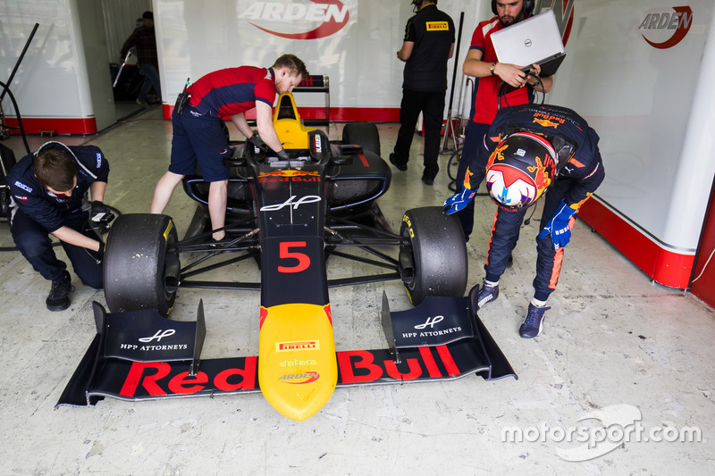 Niko Kari, Arden International, inspects his Pirelli slick tyres