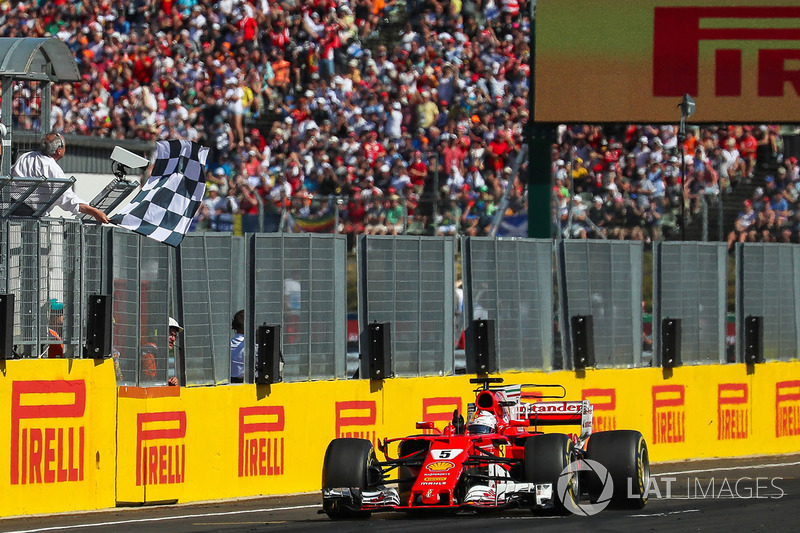 Sebastian Vettel, Ferrari SF70-H crosses the line to take the chequered flag and win the race