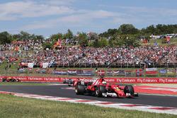 Sebastian Vettel, Ferrari SF70H, leads, Kimi Raikkonen, Ferrari SF70H,