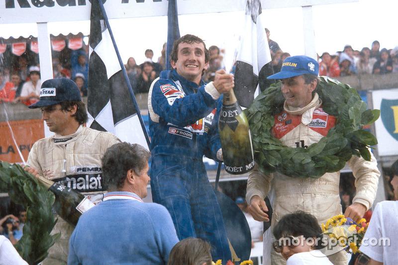 Podium: winner Alain Prost, Renault, second place John Watson, McLaren, third place Nelson Piquet, Brabham