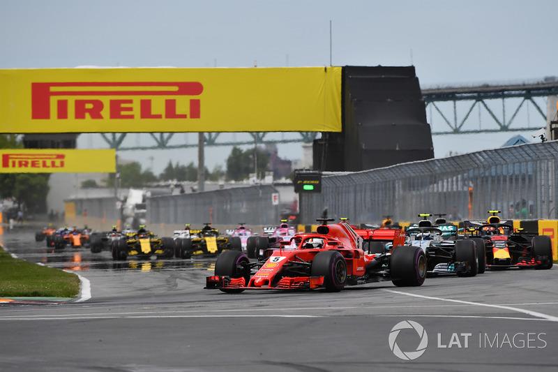 Sebastian Vettel, Ferrari SF71H leads at the start of the race