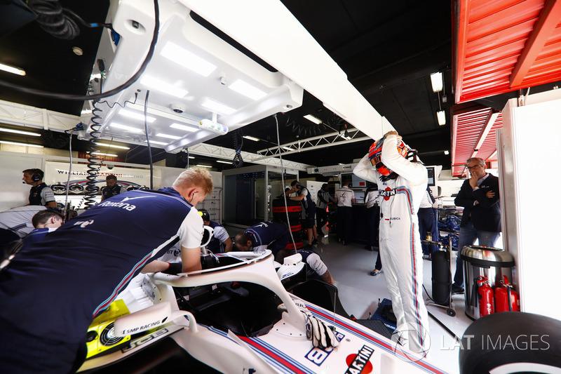 Robert Kubica, Williams Martini Racing, prepares to enter his cockpit