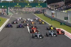Lewis Hamilton, Mercedes AMG F1 W09, leads Valtteri Bottas, Mercedes AMG F1 W09, Kimi Raikkonen, Ferrari SF71H, Sebastian Vettel, Ferrari SF71H, Nico Hulkenberg, Renault Sport F1 Team R.S. 18, Pierre Gasly, Toro Rosso STR13, Brendon Hartley, Toro Rosso STR13, and the rest of the field at the start of the race