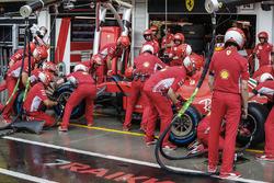 Kimi Raikkonen, Ferrari SF71H, makes a stop to change tyres