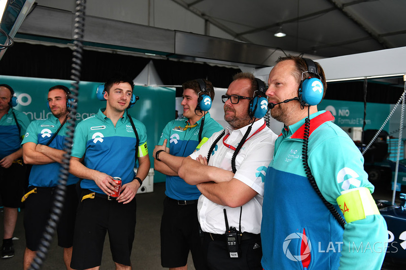 NIO team members in the garage