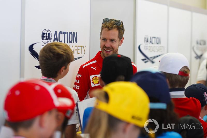 Sebastian Vettel, Ferrari, meets some kids