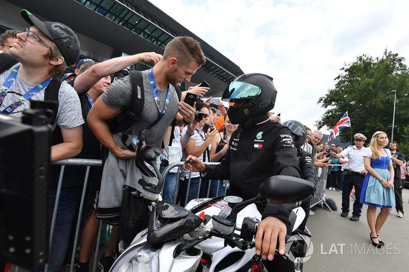 Lewis Hamilton, Mercedes-AMG F1 on his MV Agusta motorbike and fans