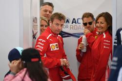 Kimi Raikkonen, Ferrari and grid kids on the drivers parade