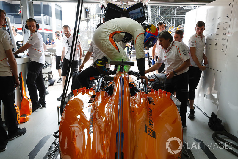 Fernando Alonso, McLaren, climbs into his car