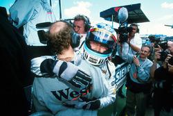 Race winner Mika Hakkinen, McLaren celebrates victory by embracing Adrian Newey, McLaren Technical D