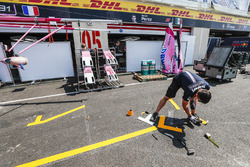 Force India team members prepare the pit lane