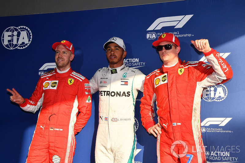 Sebastian Vettel, Ferrari, pole sitter Lewis Hamilton, Mercedes-AMG F1 and Kimi Raikkonen, Ferrari i