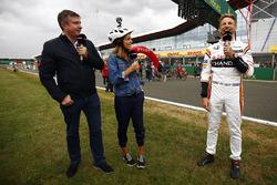 L-R: Sky pundit David Croft, Natalie Pinkham and Jenson Button, McLaren
