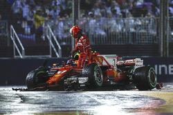 Kimi Raikkonen, Ferrari SF70H leaves his car after his collision, Max Verstappen, Red Bull Racing RB13