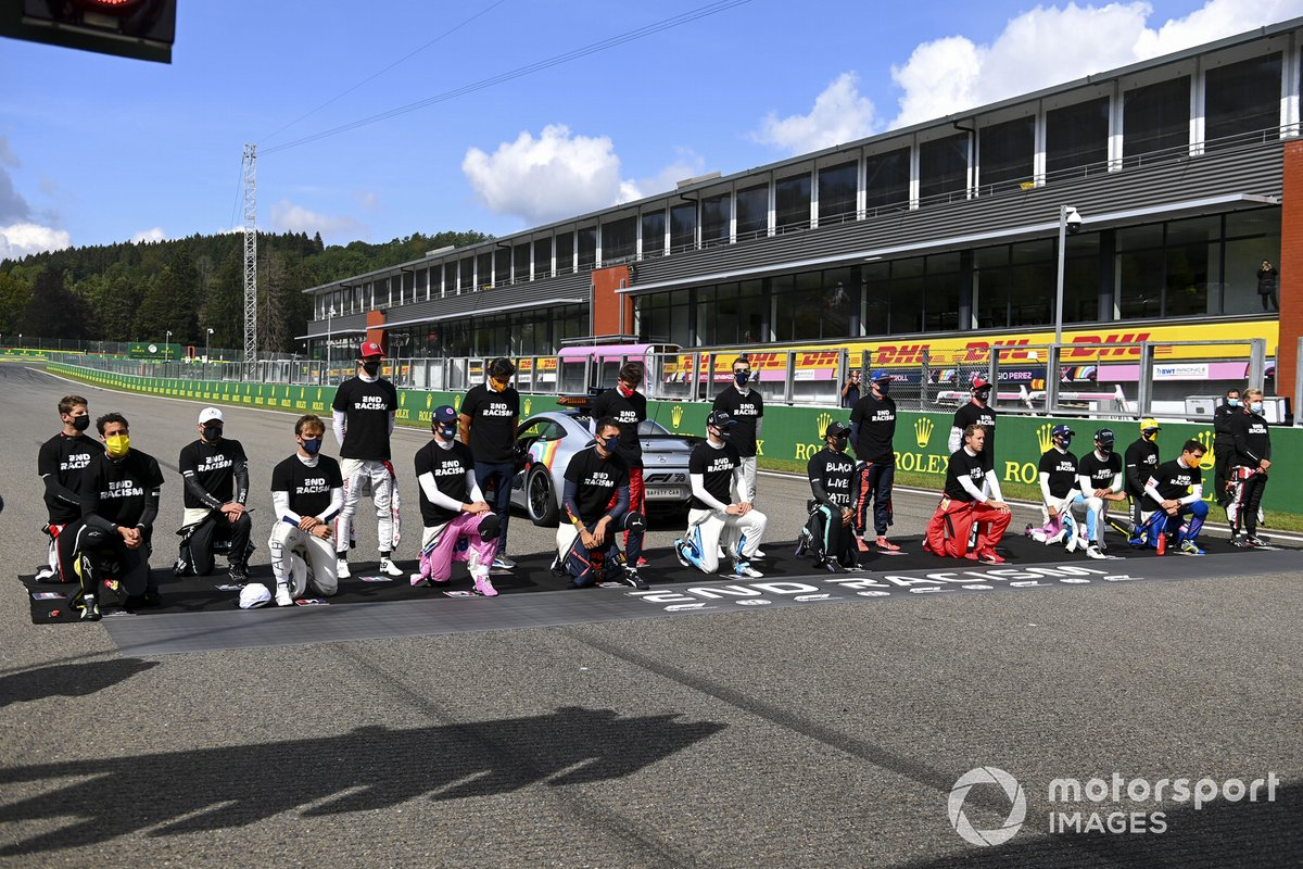 The drivers assemble on the grid in support of the End Racism campaign