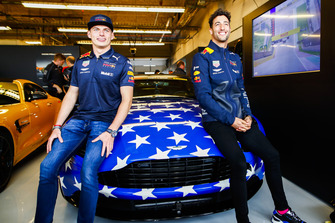 Max Verstappen, Red Bull Racing, andDaniel Ricciardo, Red Bull Racing pose for a picture with an Aston Martin car used for HotLaps