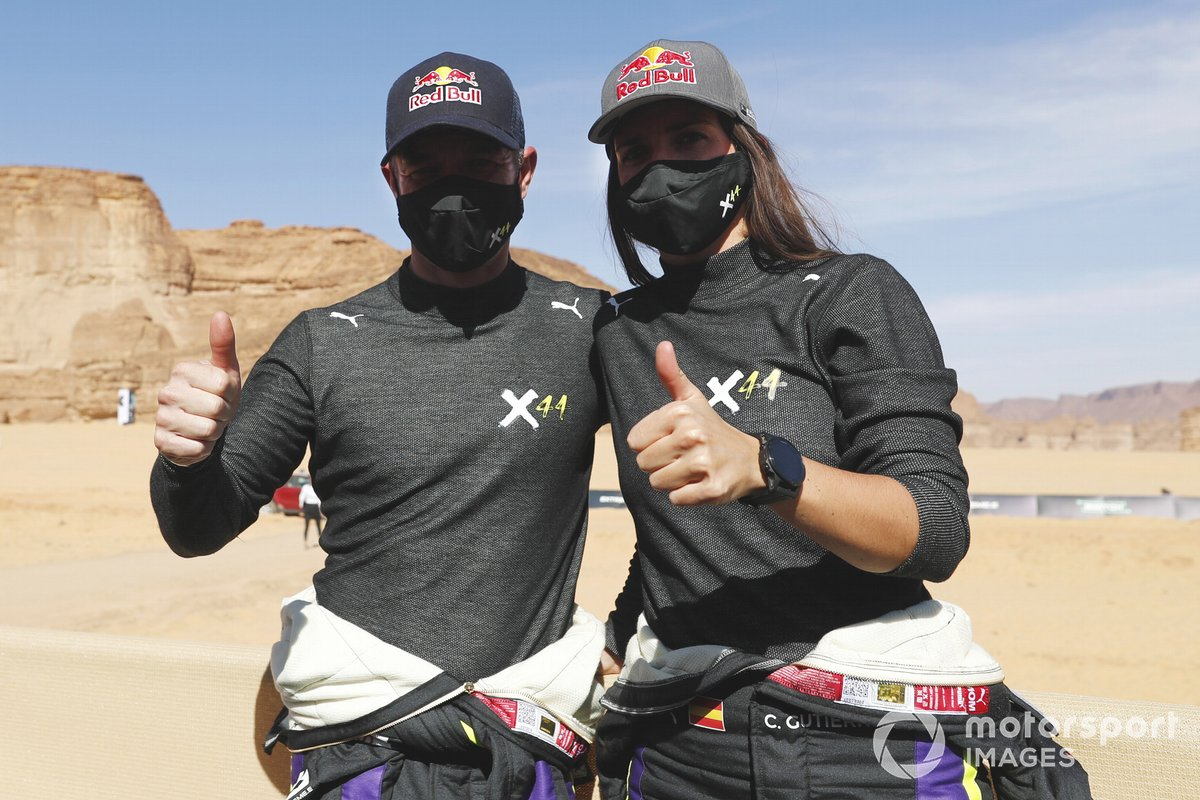 Sebastien Loeb, X44, and Cristina Gutierrez, X44, celebrate being fastest at the end of qualifying