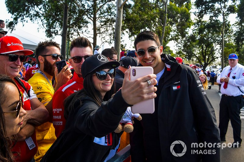 Esteban Ocon, Mercedes AMG F1 poses for a selfie with a fan.