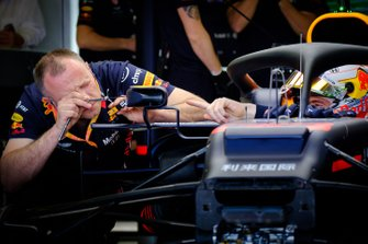 Red Bull Racing team member at work on the mirror of the car of Max Verstappen, Red Bull Racing RB15