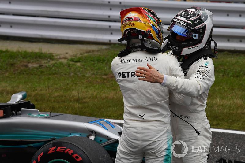 Pole sitter Lewis Hamilton, Mercedes AMG F1 and Valtteri Bottas, Mercedes AMG F1 celebrate in parc ferme