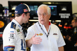 Brad Keselowski, Team Penske Ford, talks with team owner Roger Penske in the garage area
