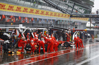 Sebastian Vettel, Ferrari SF70H, Kimi Raikkonen, Ferrari SF70H, return to the pits