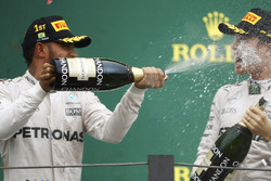 Lewis Hamilton, Mercedes AMG F1 sprays champagne over team-mate Nico Rosberg, Mercedes AMG F1 on the podium