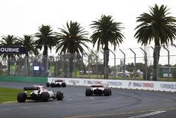 Esteban Ocon, Force India VJM10, follows a Ferrari and a Williams