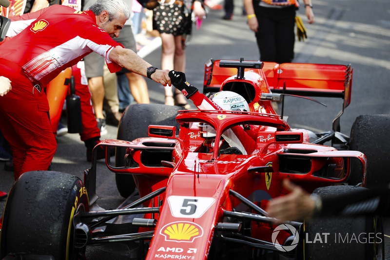 Sebastian Vettel, Ferrari SF71H, is greeted by Maurizio Arrivabene, Team Principal, Ferrari, after taking victory