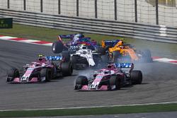 Sergio Perez, Force India VJM11 Mercedes, leads Esteban Ocon, Force India VJM11 Mercedes, Sergey Sirotkin, Williams FW41 Mercedes, Stoffel Vandoorne, McLaren MCL33 Renault, and Brendon Hartley, Toro Rosso STR13 Honda