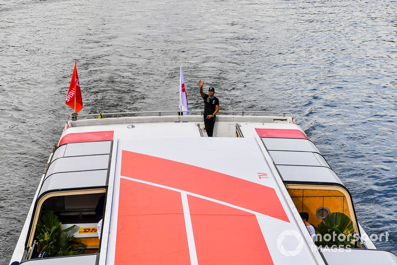 Lewis Hamilton, Mercedes AMG F1 waves to fans from the boat on the way to the Federation Square event