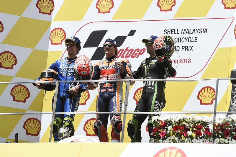 Подіум: друге місце Алекс Рінс, Team Suzuki MotoGP, переможець гонки Марк Маркес, Repsol Honda Team, третє місце Жоанн Зарко, Monster Yamaha Tech 3