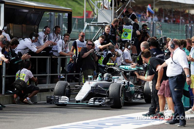 Race winner Nico Rosberg, Mercedes AMG F1 W07 Hybrid celebrates as he enters parc ferme