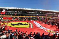 Fans and giant Ferrari flag