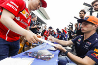Max Verstappen, Red Bull Racing, signs an autograph