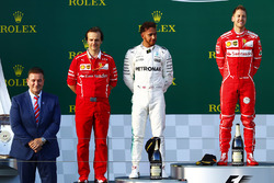 Podium: race winner Sebastian Vettel, Ferrari, second place Lewis Hamilton, Mercedes AMG, and Luigi Fraboni, Head of Power Unit Race Operation, Ferrari