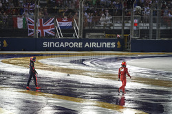 Max Verstappen, Red Bull Racing and Kimi Raikkonen, Ferrari walk on track after colliding and crashing out at the start of the race