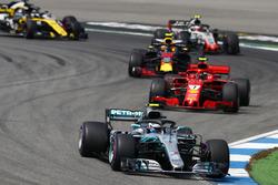 Valtteri Bottas, Mercedes AMG F1 W09, leads Kimi Raikkonen, Ferrari SF71H, and Max Verstappen, Red Bull Racing RB14