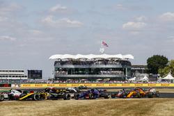 Carlos Sainz Jr., Renault Sport F1 Team R.S. 18, leads Pierre Gasly, Toro Rosso STR13, and Fernando Alonso, McLaren MCL33