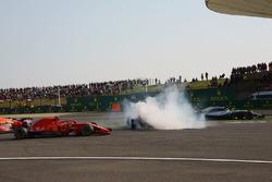 Max Verstappen, Red Bull Racing RB14 and Sebastian Vettel, Ferrari SF71H clash as Kimi Raikkonen, Ferrari SF71H and Lewis Hamilton, Mercedes-AMG F1 W09 EQ Power+ pass