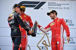 Max Verstappen, Red Bull Racing, Sebastian Vettel, Ferrari and Kimi Raikkonen, Ferrari celebrate on the podium with the champagne