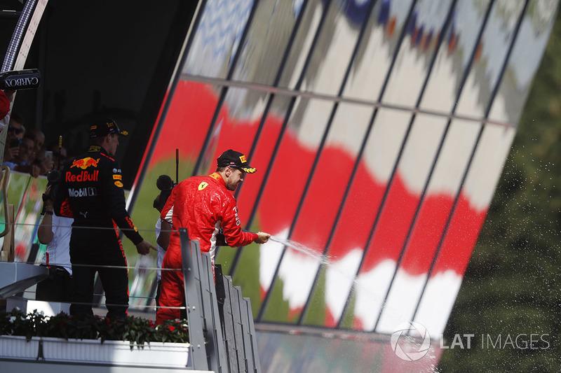 Podium: third place Sebastian Vettel, Ferrari, sprays champagne on the podium, along with race winner Max Verstappen, Red Bull Racing