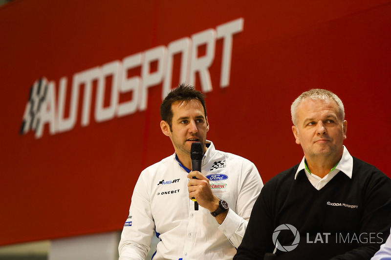 Hyundai development driver Jari Huttunen on stage, with M-Sport and Hyundai representatives