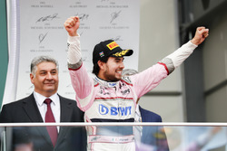 Sergio Perez, Force India, 3rd position, celebrates as he arrives on the podium