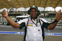 Lotus Racing Team Principal Tony Fernandes celebrates after the team got into the Q2 session