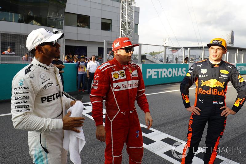 The top-three qualifiers. Pole winner Lewis Hamilton, Mercedes AMG F1, Kimi Raikkonen, Ferrari, Max Verstappen, Red Bull Racing